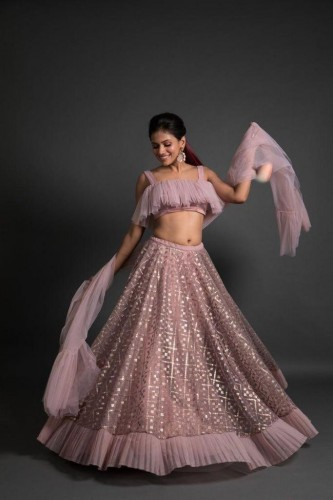 Capricious Baby Pink Net With Embroidered Work Lehenga Choli VT3091122A